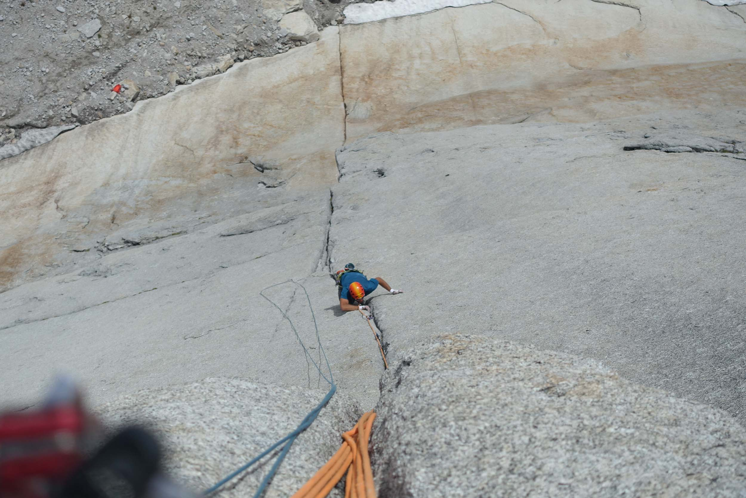 Jesse following one of the seamed out 5.12b flared crack cruxes. Photo Maury Birdwell