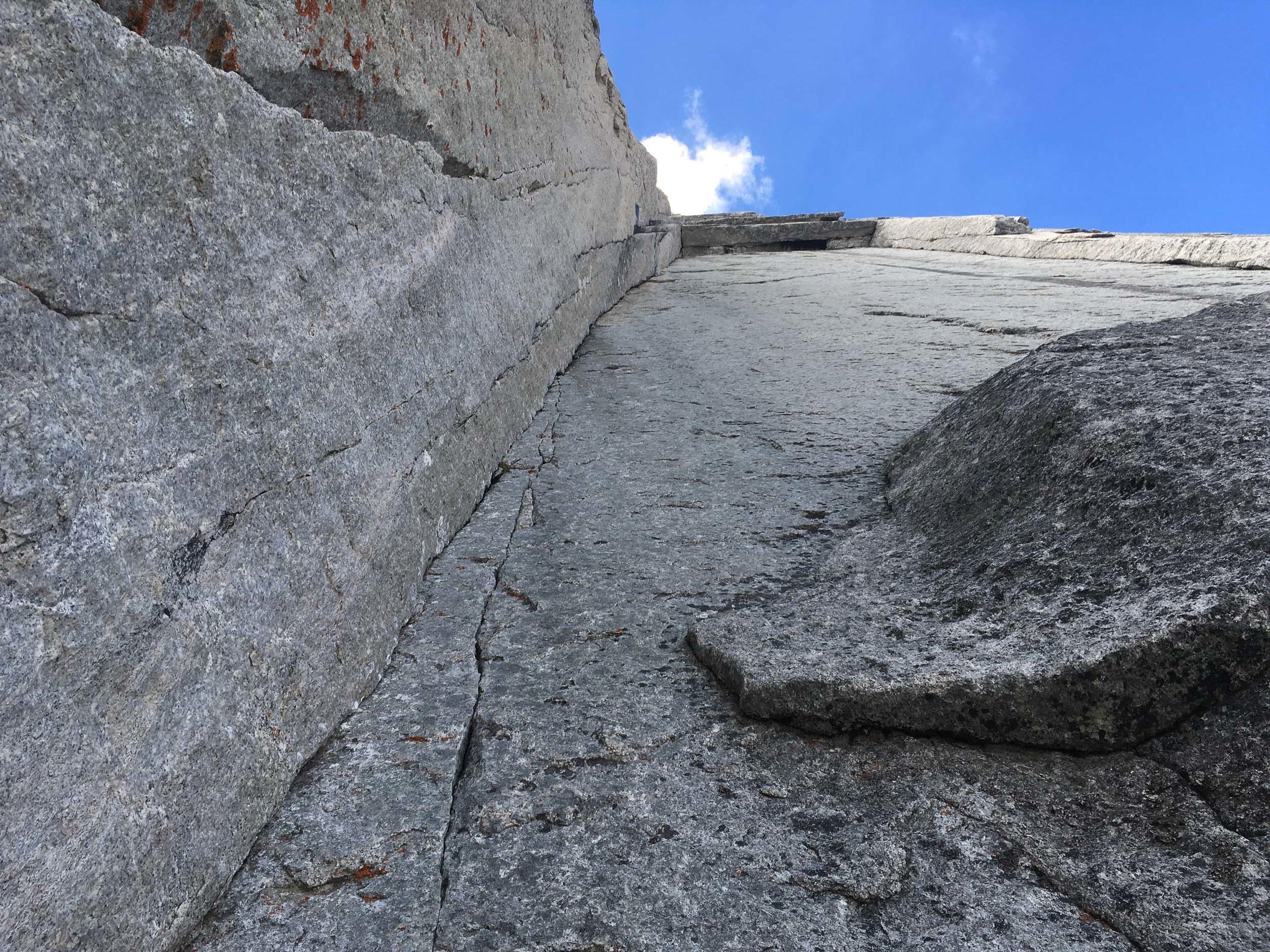 Looking up at the steep and thin crux climbing on the Armageddon.